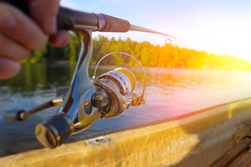 Download Fishing at sunset stock photo. Image of sport, fish, hook - 43390380