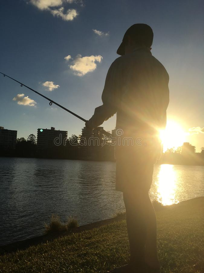 Fishing at sunset royalty free stock images