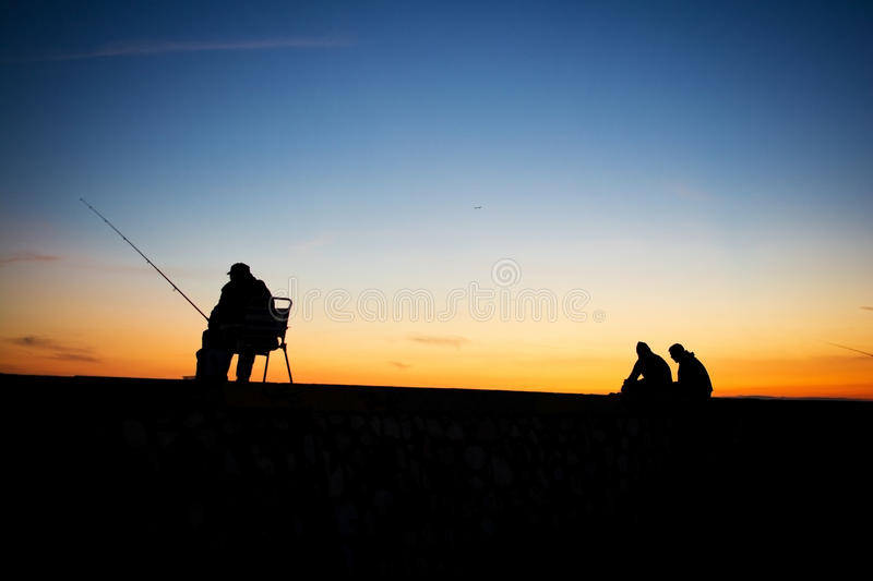 Download Fishing at sunset stock image. Image of silhouette, sport - 47962535