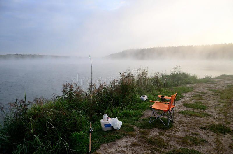 Fishing supplies on river in morning in fog. Fishing supplies on a river in the morning in fog stock photography