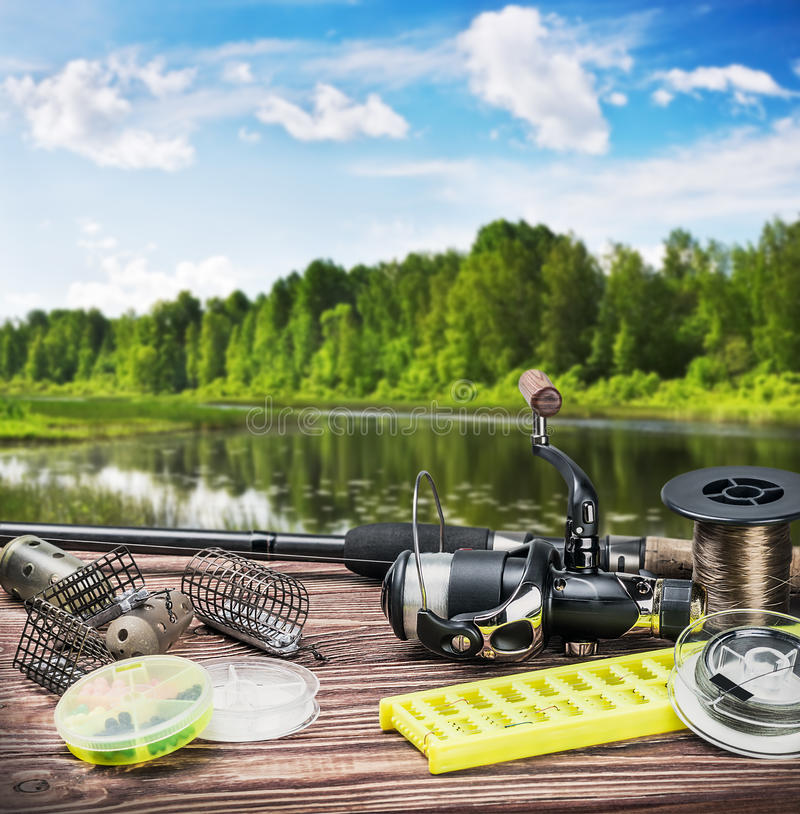 Fishing tackle and accessories on the table. Summer day stock photos