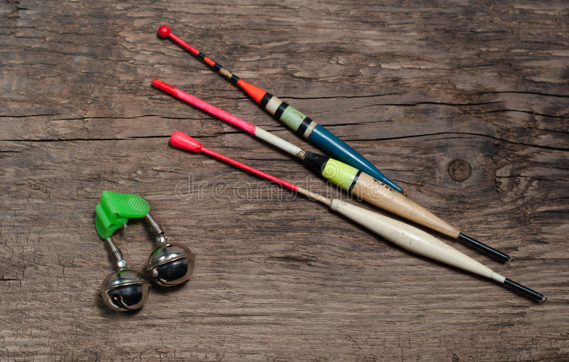 Fishing tackle and bait. On wooden background stock images
