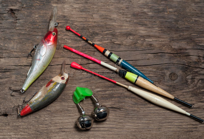 Fishing tackle and bait. On wooden background stock photo