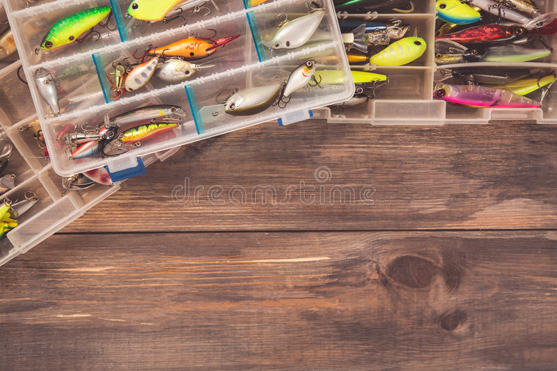 Fishing tackle boxes on wooden background with free space. Top view.  royalty free stock photography