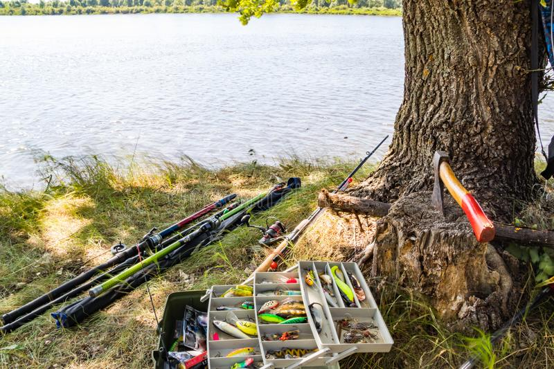 Fishing tackle for catching predatory fish on the river bank in summer stock photo