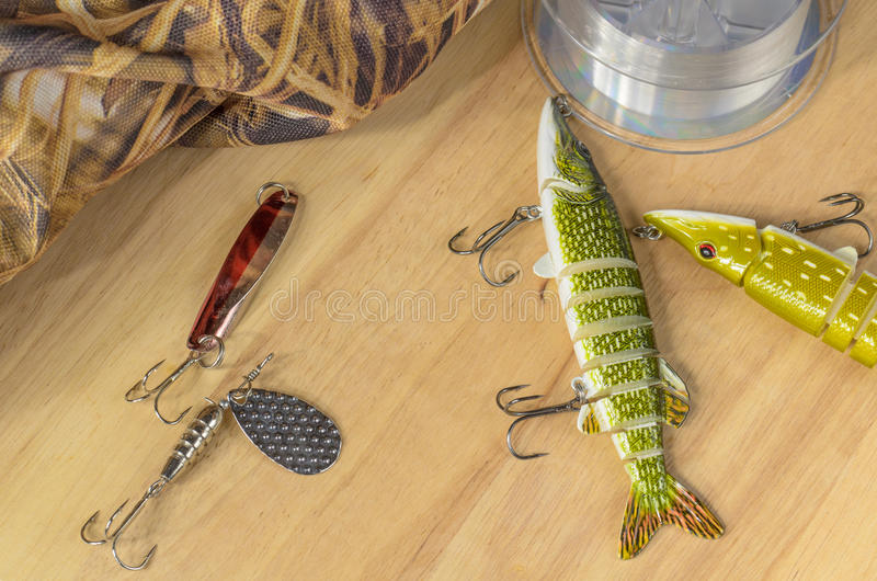 Fishing tackle and fishing lures on the background of the wooden planks. stock image