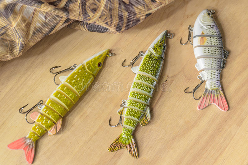 Fishing tackle and fishing lures on the background of the wooden planks. stock photography