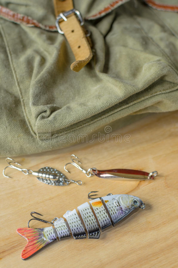 Fishing tackle and fishing lures on the background of the wooden planks. stock images