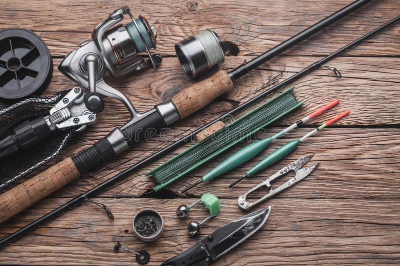 Fishing tackle for fishing peaceful fish. Float, fishing rod, reel, fishing line. On the wooden background stock image
