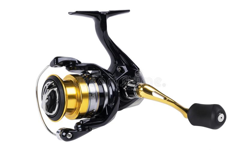 Fishing tackle. Fishing reel isolated on white background with clipping path. Modern fishing reel isolated. Empty space. Copy spac. E. Mockup stock photography