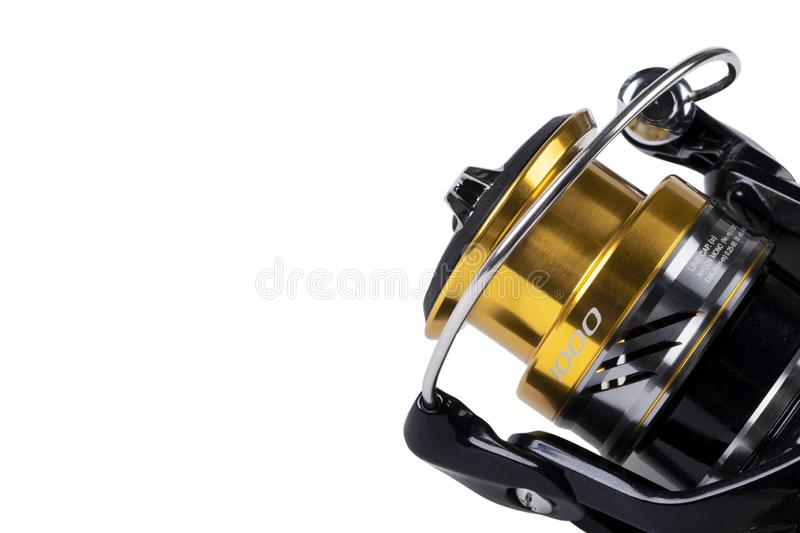 Fishing tackle. Fishing reel isolated on white background with clipping path. Modern fishing reel isolated. Empty space. Copy spac. E. Mockup royalty free stock photo