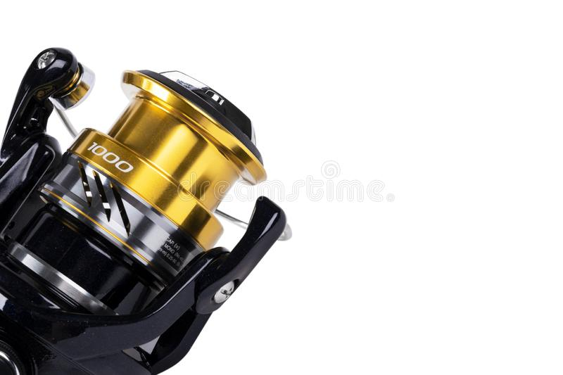 Fishing tackle. Fishing reel isolated on white background with clipping path. Modern fishing reel isolated. Empty space. Copy spac. E. Mockup stock images