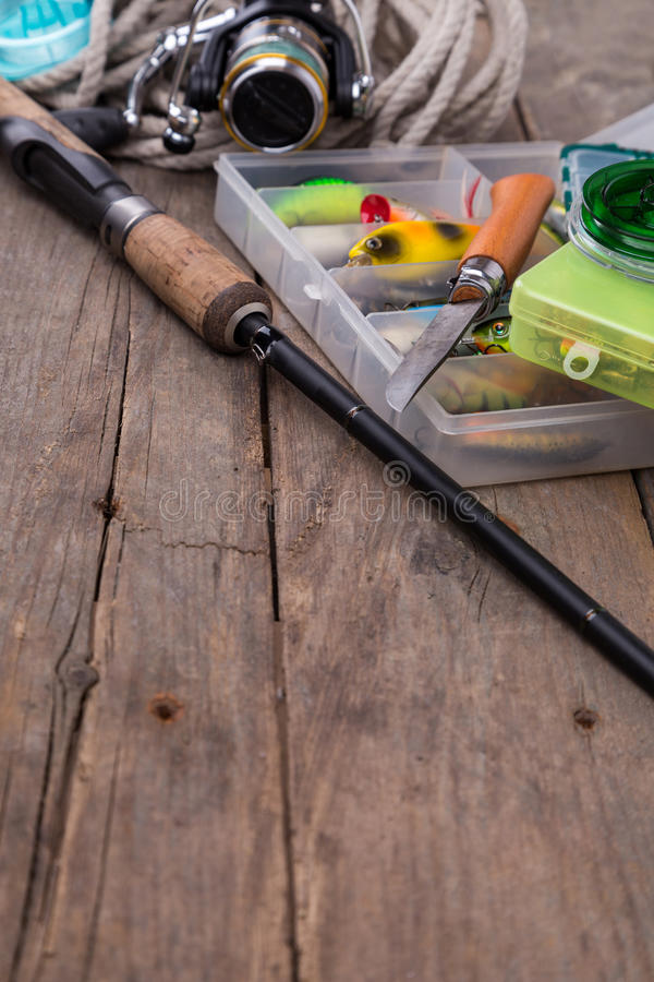 Fishing tackles and baits in storage boxes stock photography