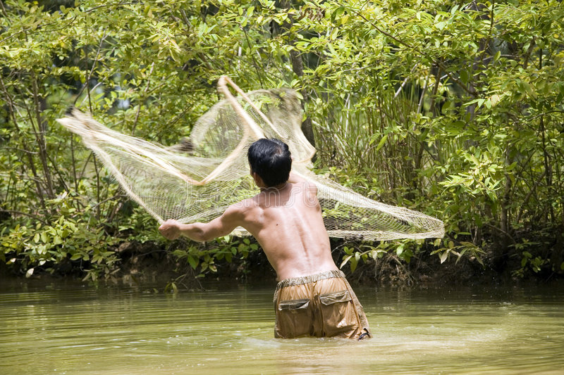 Fishing with a throw net stock photos