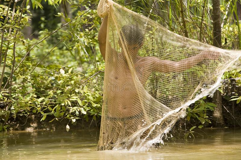 Download Fishing with a throw net stock image. Image of fisherman - 4636659