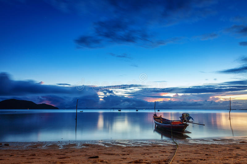 Fishing and touristic boats at sunset royalty free stock photography