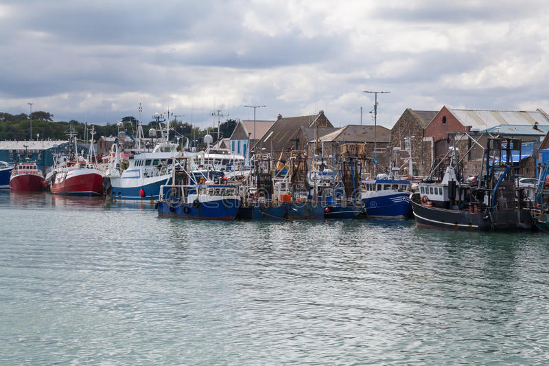 Fishing trawlers berthed at the quay stock images