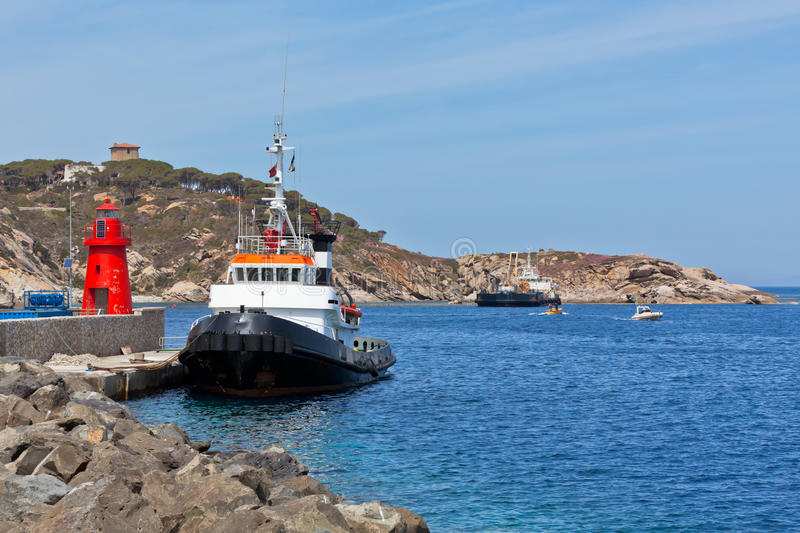 Download Fishing Trawlers And Small Red Lighthouse Stock Image - Image: 28850901