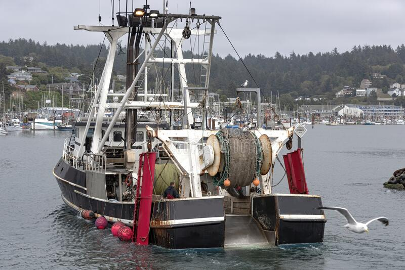 Fishing vessel returning to port in Newport Oregon royalty free stock images