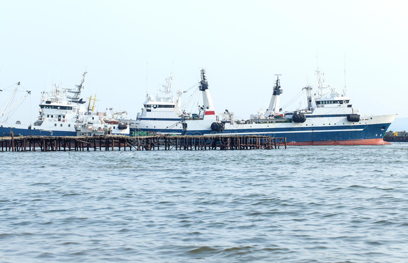 Fishing vessels at a mooring. On Kamchatka stock images