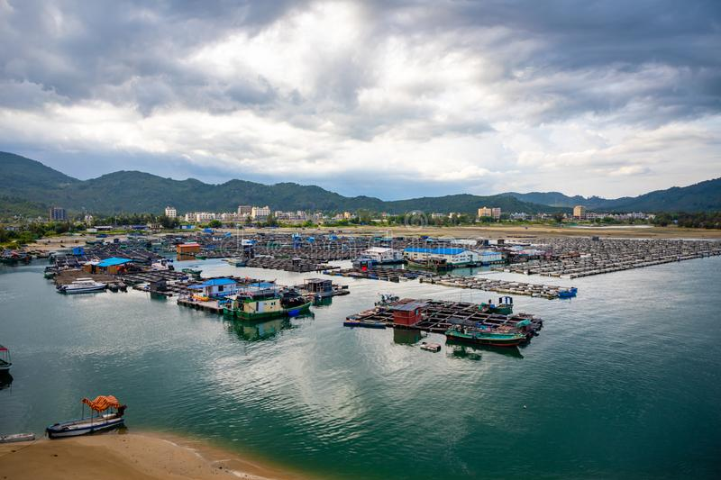 A fishing village of fishermans on the sea water in island Hainan in China royalty free stock photo