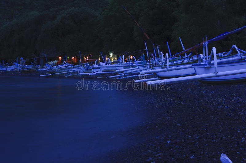 Fishing village at night. Fishing village on Bali. It can be used to illustrate about travel, nature, ocean, boat, fishing, philosophy and poetry stock photo