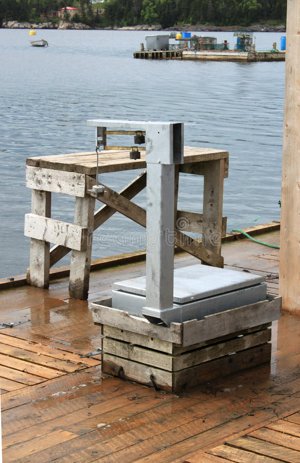 Fishing Weighing Scale On Pier Stock Photography