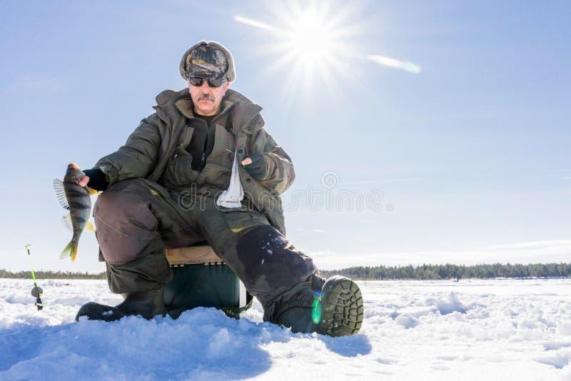 Fishing winter bass winter sport, winter hobby stock photo