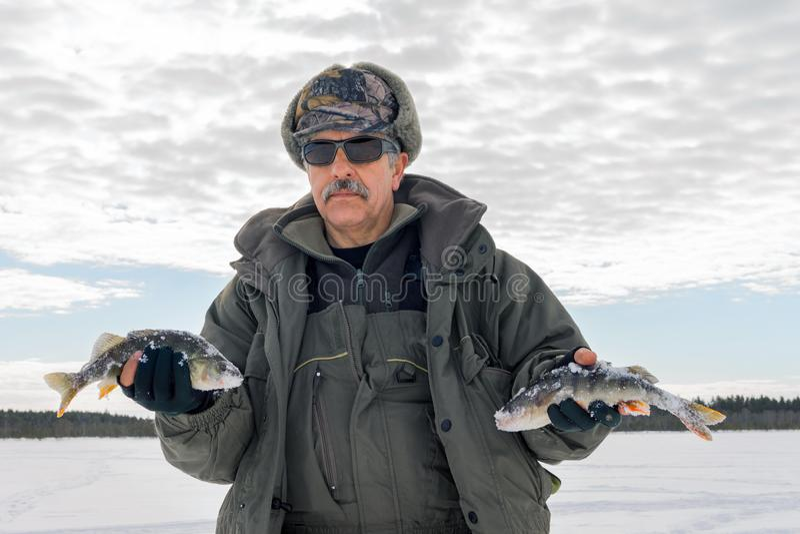 Fishing winter bass winter sport, winter hobby stock images