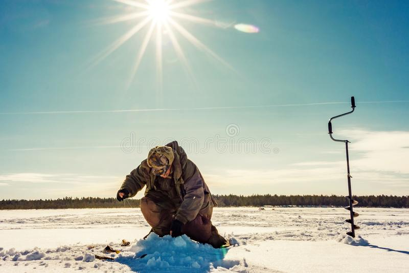 Fishing winter bass winter sport, winter hobby royalty free stock photos