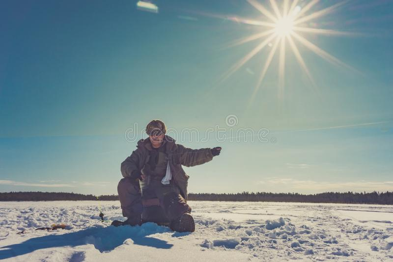 Fishing winter bass winter sport, winter hobby royalty free stock photography