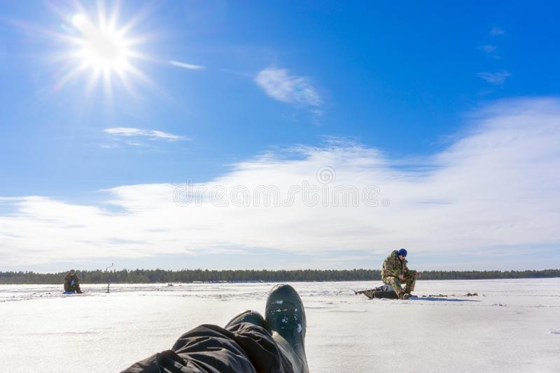 Fishing on the winter lake stock images
