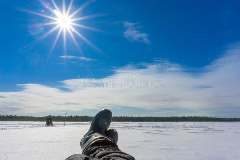 Fishing on the winter lake stock image