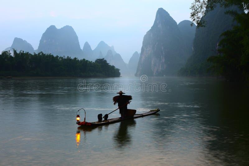 Fishman in Lijiang river dawn. Guilin China March 21,2014, the fishman in the Lijiang river dawn stock photo