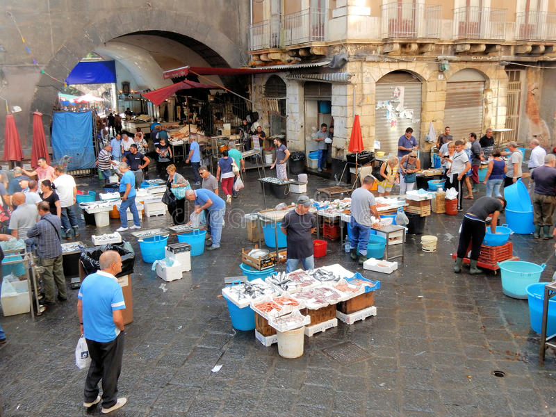 Catania - Fishmarket - Sicily - Southern Italy. Fishmarket in the heart of Catania, fishmongers sell various types of fish in the square Piazza Alonzo di stock image