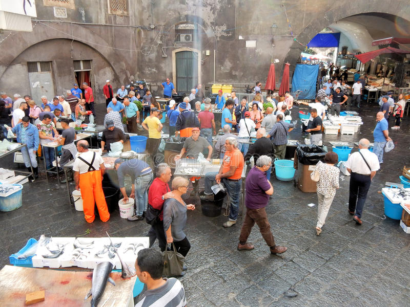 Fishmarket in the heart of Catania - Sicily - Southern Italy. Fishmarket in the heart of Catania, fishmongers sell various types of fish in the square Piazza royalty free stock photos