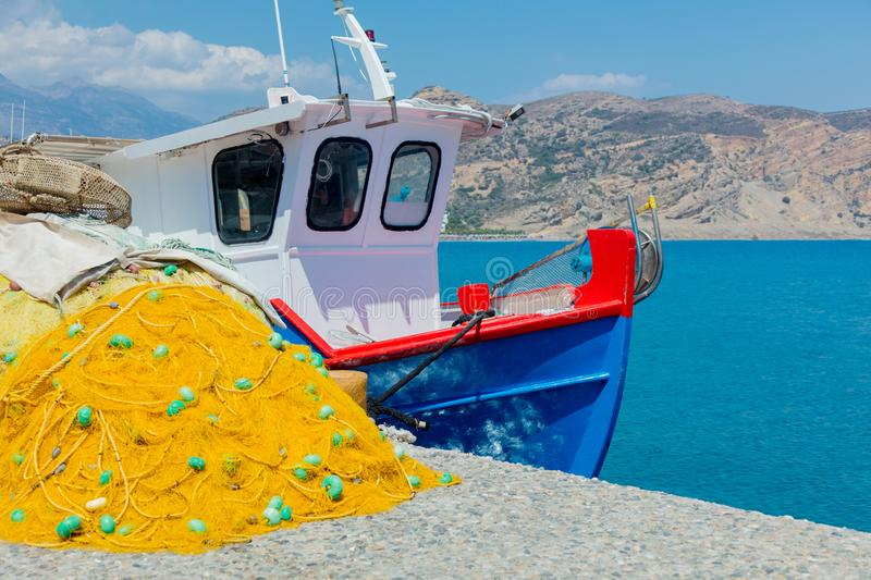 Fishnet and boat in a port of Agia Galini stock photos