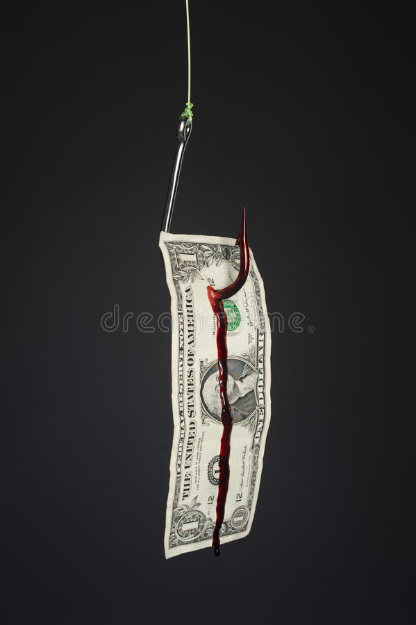 Fishook and money on gray background royalty free stock photo