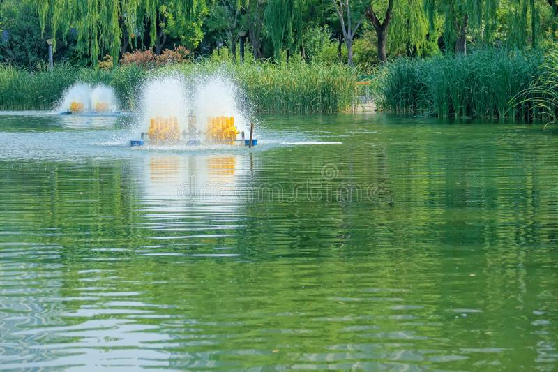 Aerator. The fishpond aerator is working in lake royalty free stock images