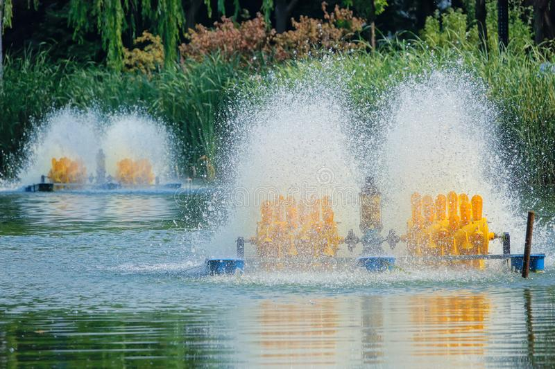 Aerator. The fishpond aerator is working in lake royalty free stock image