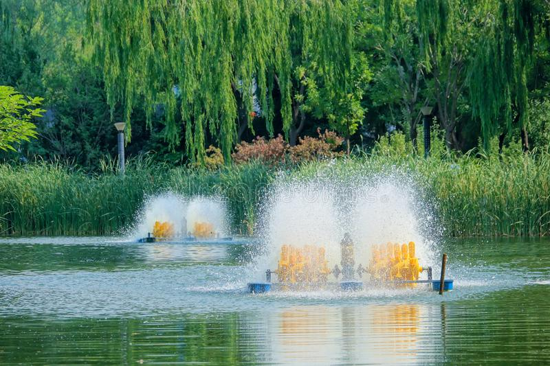 Aerator. The fishpond aerator is working in lake stock photography