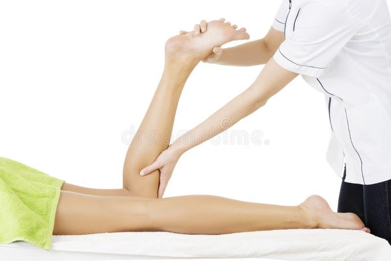 Fisio terapista che prova a riparare le gambe immagine stock libera da diritti
