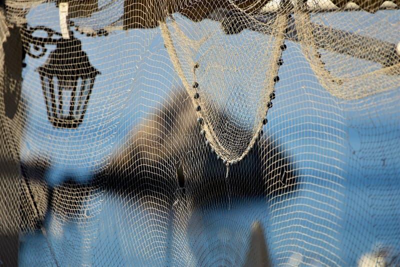Fiskare - gammalt nät arkivfoto