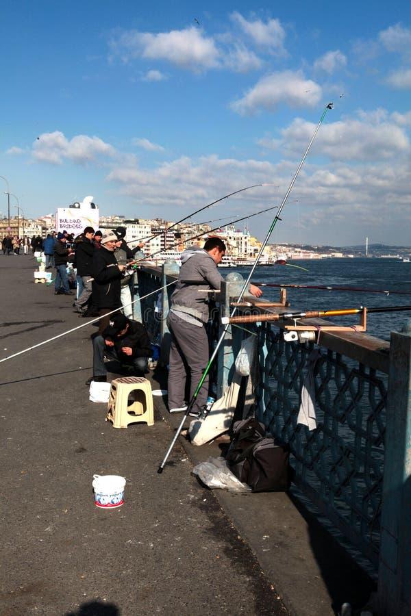 Fiskare på bron royaltyfria foton
