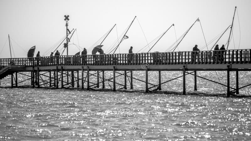 Fiskare på hamnplatsen royaltyfria foton