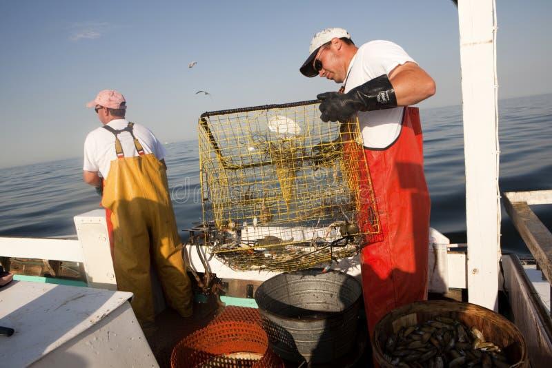 Fiskare på havet royaltyfri foto