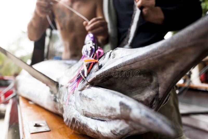 Fiskare rymmer deras lås arkivfoto