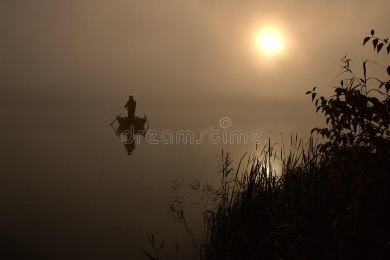 Fiskare Silhouette royaltyfria bilder