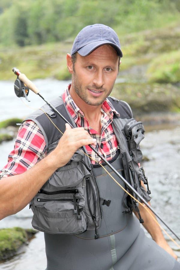 fiskarestående royaltyfri foto