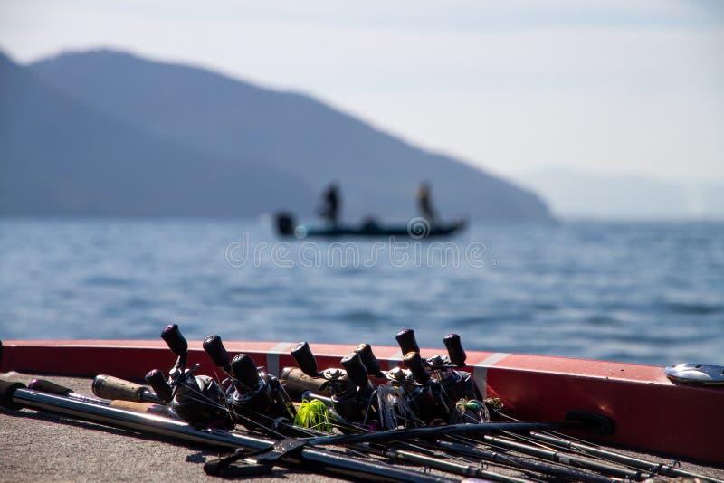 Fiskeutrustning på en båt, som fiskar i sjön royaltyfri foto
